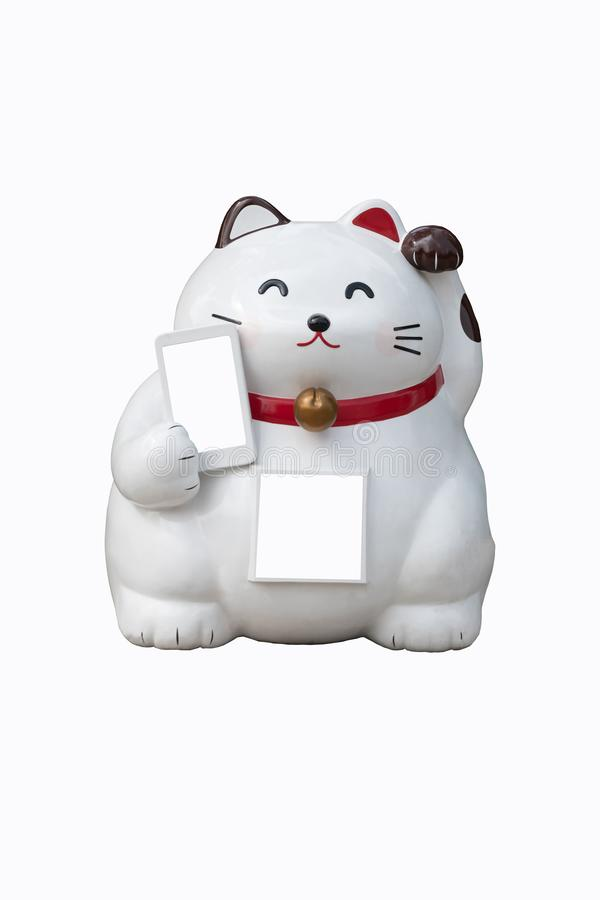 A white chinese lucky cat with its left paw raised another one holding mobile phone isolated on white background stock images