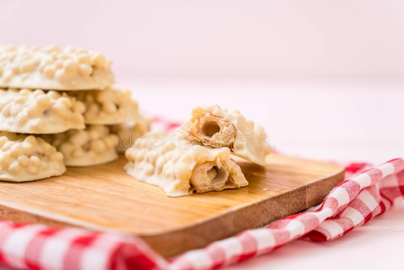 White chocolate with caramel and cereal crispy bar. On wood stock photos