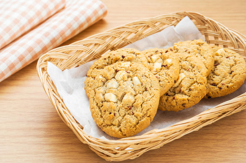 White chocolate chip with raspberry cookie in basket. White chocolate chip with raspberry cookie in a basket stock photo