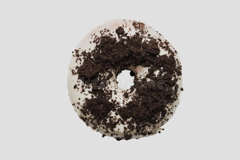 White chocolate glazed doughnut with chocolate sprinkle on top on white background. High resolution image for food industry stock photo