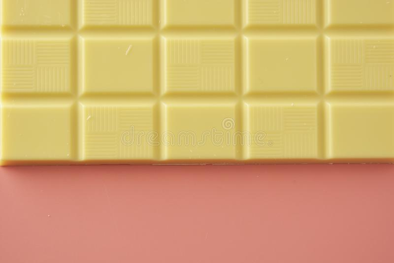White chocolate isolated over pink background. Copy space. Flat lay, food, texture, birthday, sweet, bar, delicious, dessert, ingredient, gourmet, tasty, piece royalty free stock photography