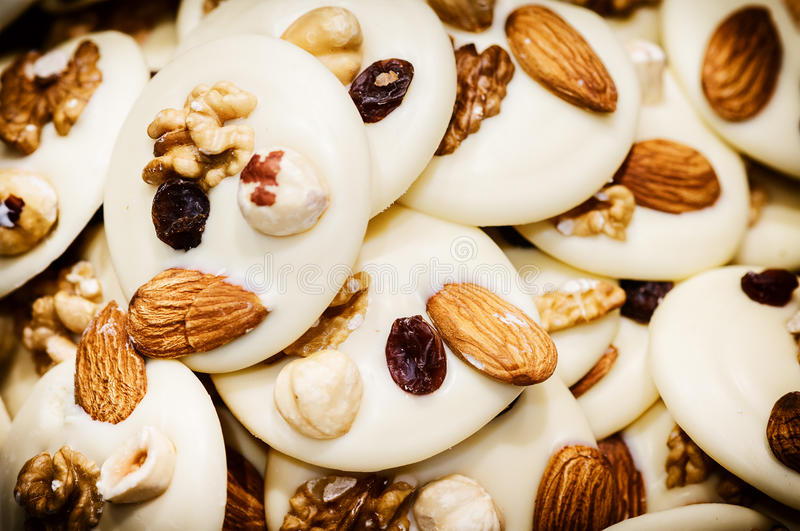 White chocolate mendiants with dried fruits stock images