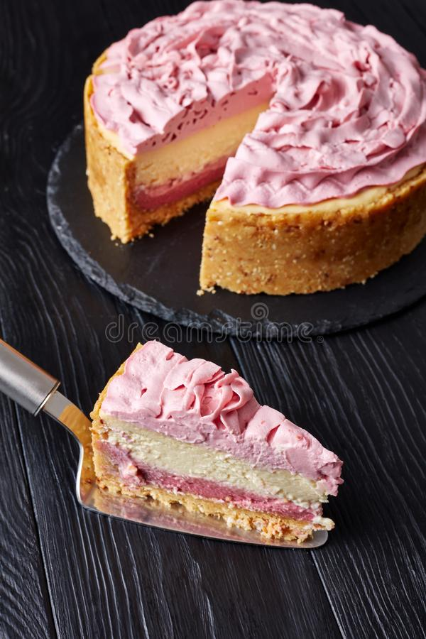 White chocolate and raspberry cheesecake, top view stock image