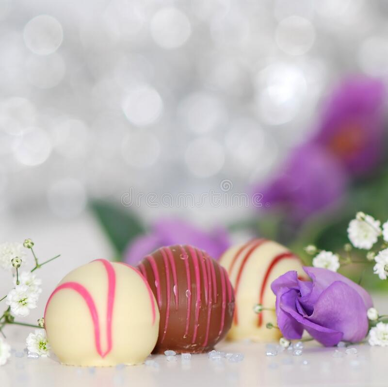 White And Chocolate Sweets With Purple Petal Flower Photo Free Public Domain Cc0 Image