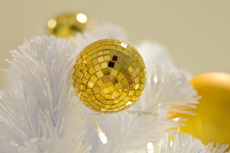 White christmas background Golden balls. Silver christmas decorations hanging from white twig floral arrangement royalty free stock image
