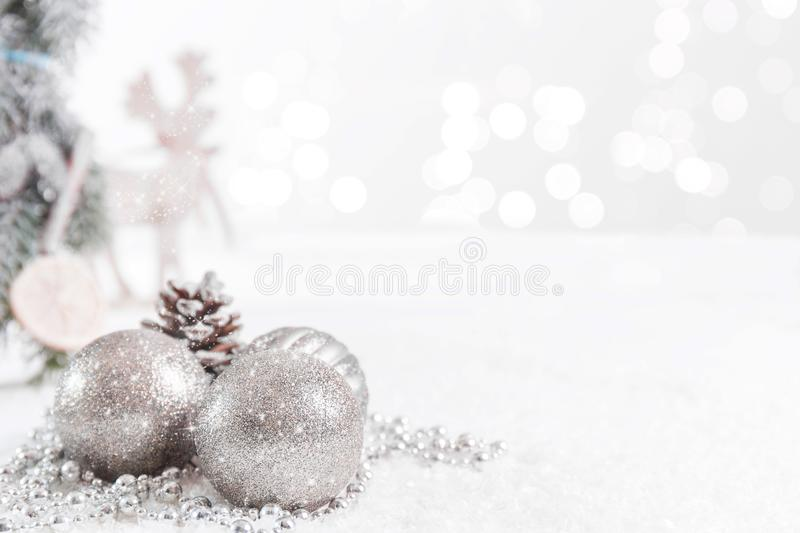 Christmas balls and fir branches with stars and a reindeer against a Blurred background stock photo