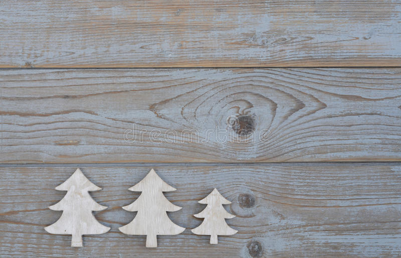 White christmas decoration christmas tree on a old grey wooden background with empty copy spac. White christmas decoration christmas tree on a old grey wooden stock photo