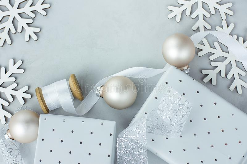 White Christmas Decoration Ornaments Frame Composition Gift Boxes Balls Snow Flakes Silk Swirl Ribbon Poster Banner Template. Copy Space stock image