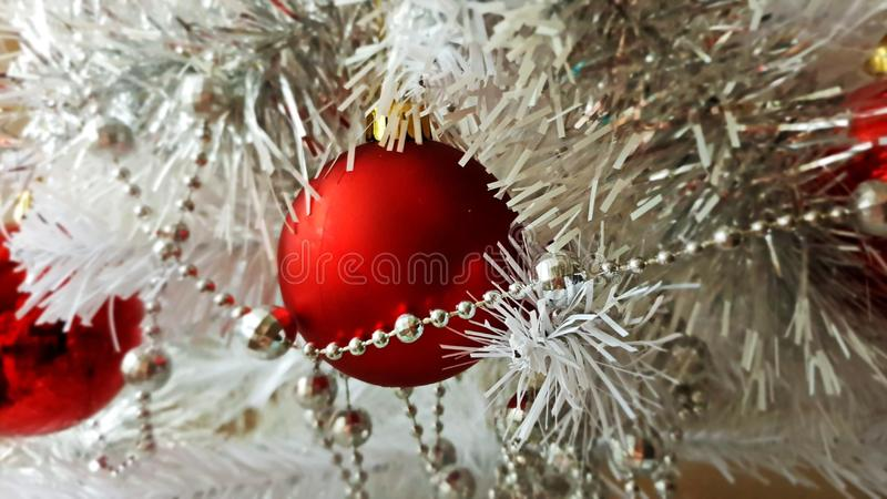 White Christmas decoration tree, red ,gold ,silver,white balls silver garland,christmas light,decoration ,illumination ideas royalty free stock photo