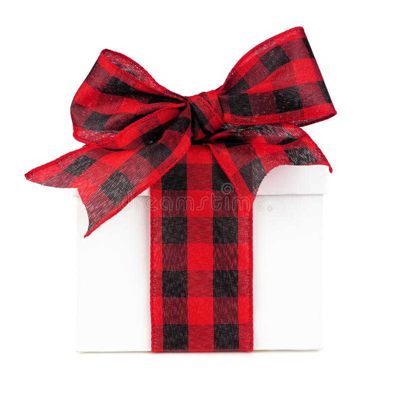 White Christmas gift box with red and black buffalo plaid bow and ribbon isolated on white. White Christmas gift box with red and black buffalo plaid bow and royalty free stock images