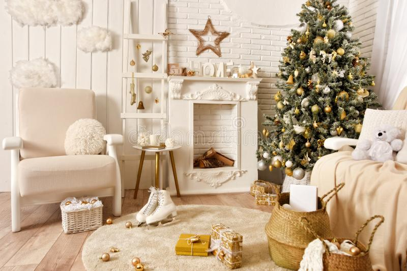 White Christmas interior. Beautiful Christmas tree, armchair, baskets, gifts, skates, stairs and other decoration.  royalty free stock photography