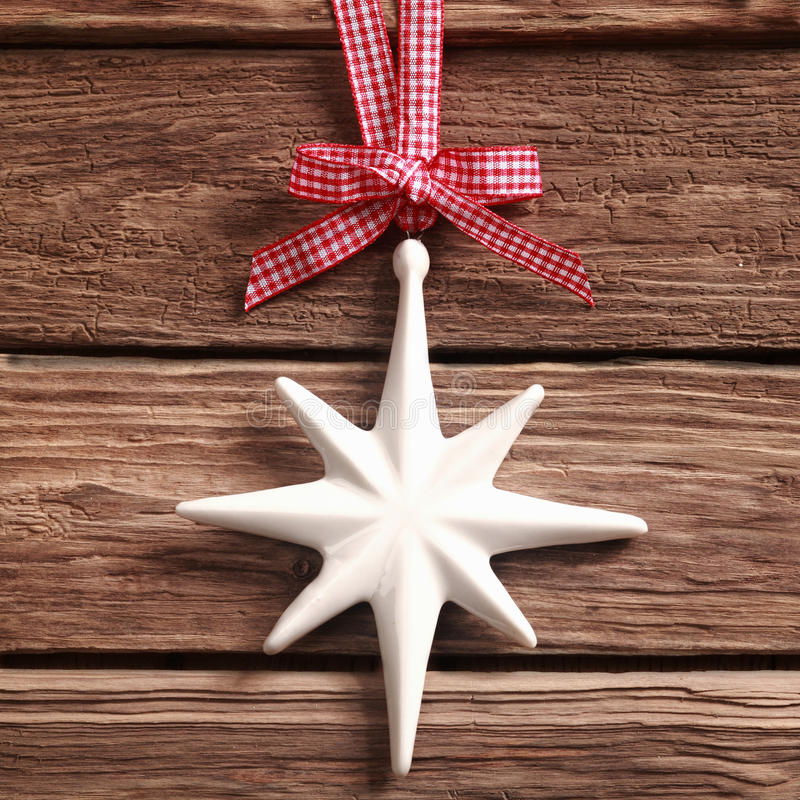 White Christmas star ornament on rustic wood stock images