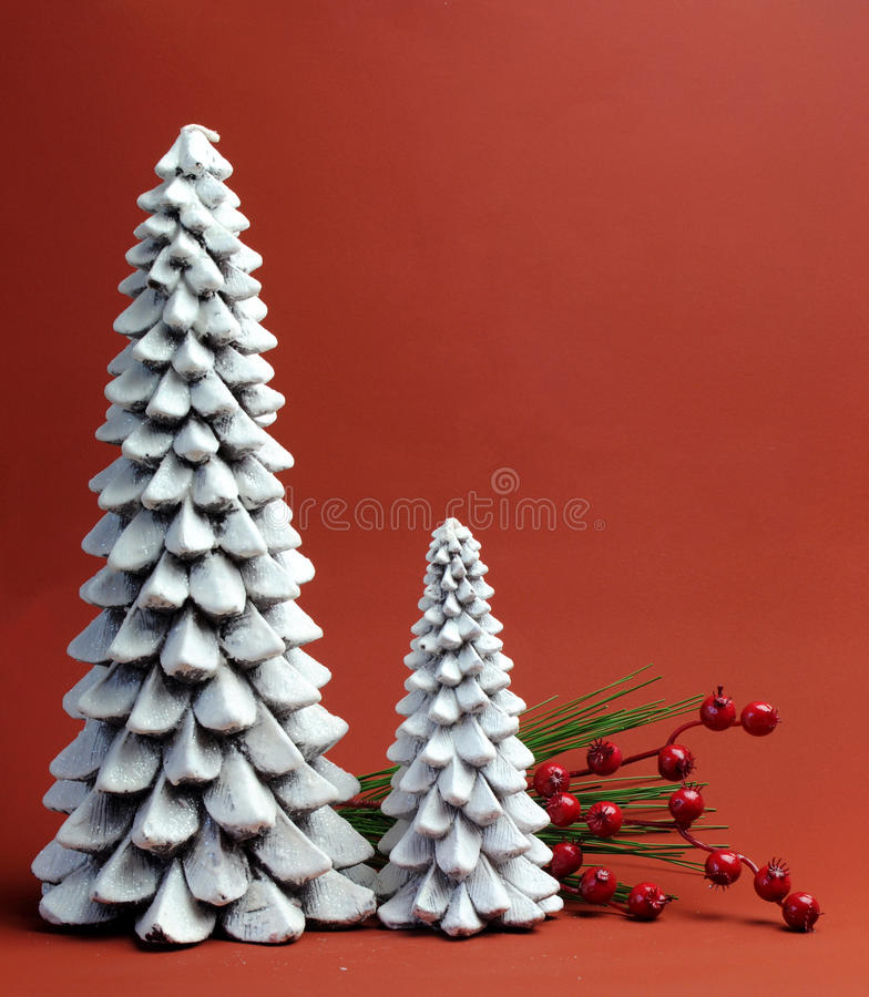 White Christmas Tree candles with pine and berries holiday still life stock photography