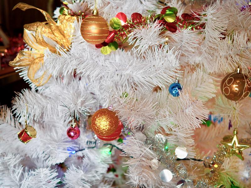 White Christmas tree decorate with colorful shinny ball and light for long weekend celebration stock photography