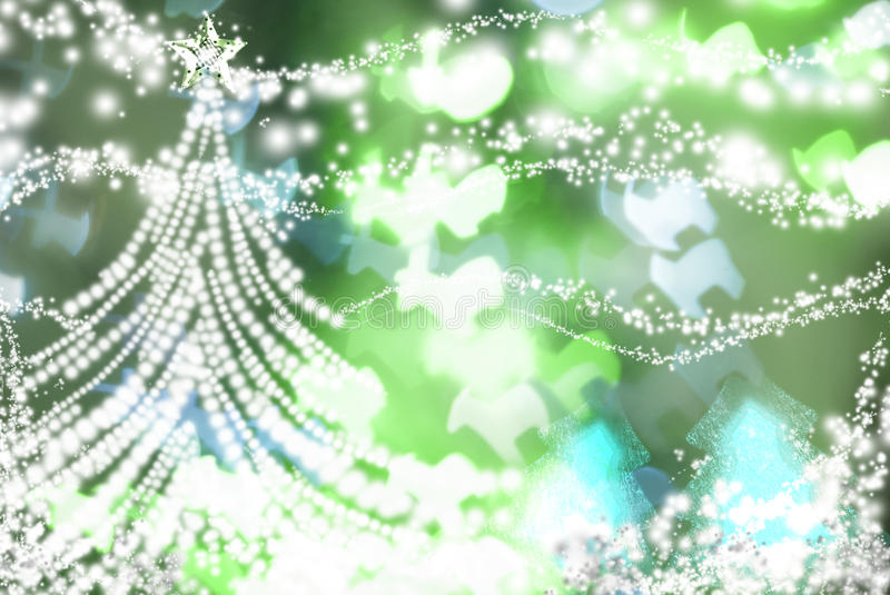 White christmas tree on green sparkly background stock photo