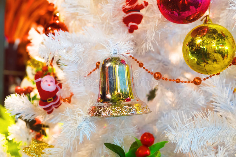 White christmas tree hang toy bell stock photos