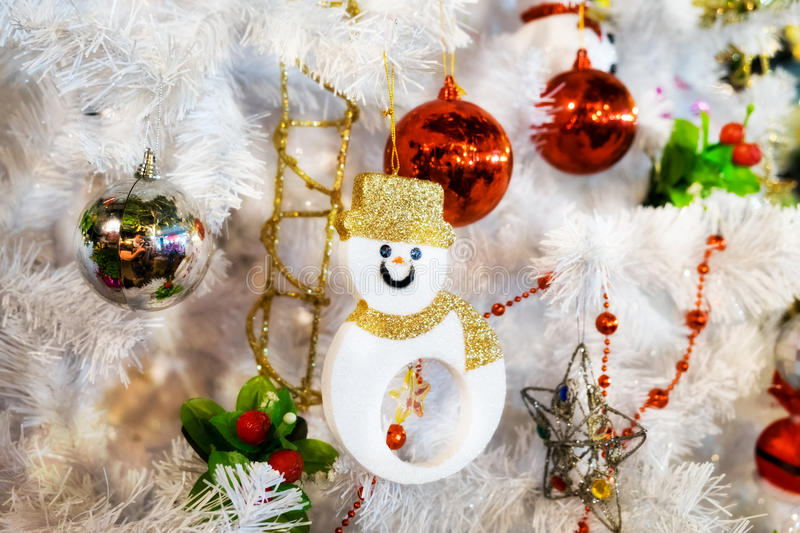 White christmas tree hang toy snowman stock photography