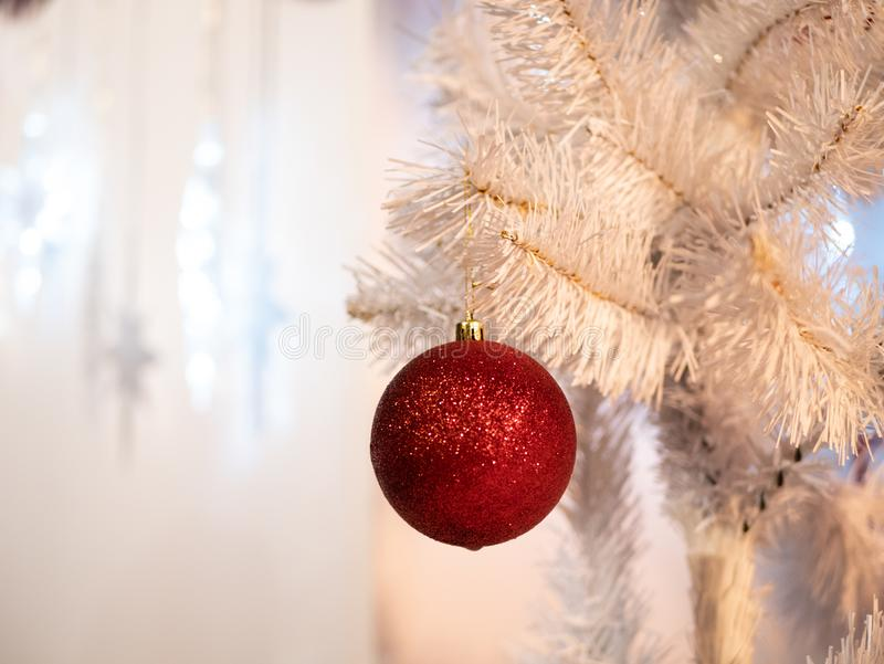 White Christmas tree with one red glass ball royalty free stock images