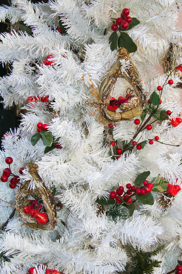 White christmas tree with red decorations royalty free stock images