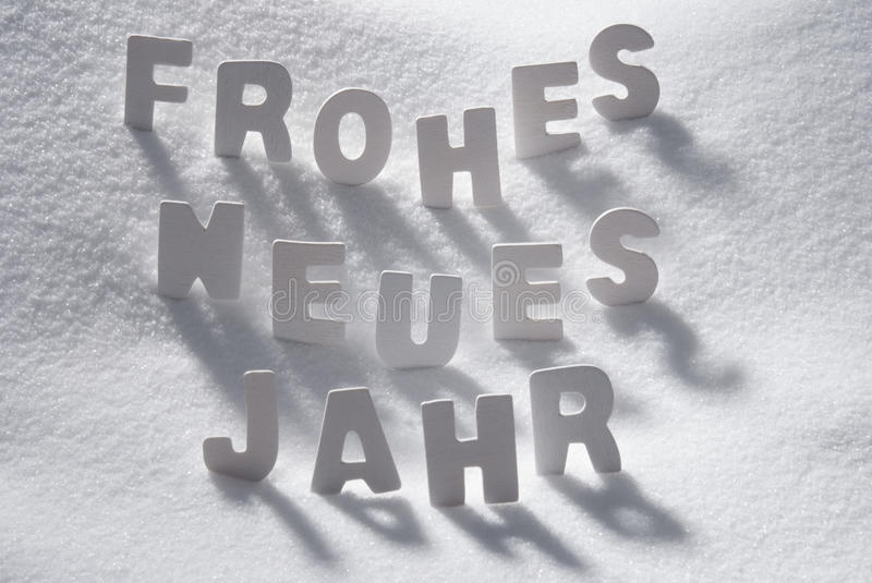 White Christmas Word Neues Jahr Means New Year On Snow. White Wooden Letters Building GermanText Frohes Neues Jahr Means Happy New Year. Snow And Snowy Scenery royalty free stock photo