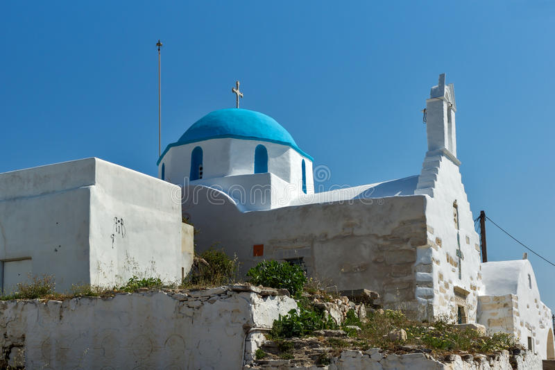 White chuch with blue roof in town of Parakia, Paros island, Greece. White chuch with blue roof in town of Parakia, Paros island, Cyclades, Greece stock images