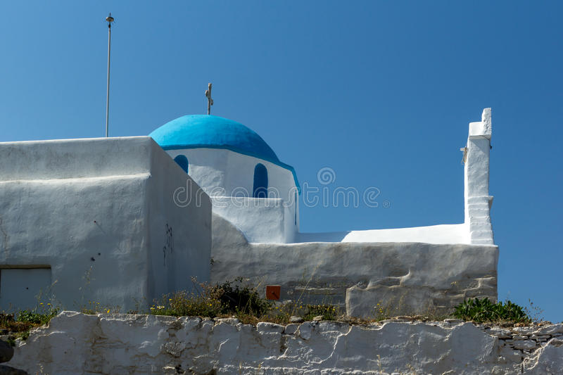 White chuch with blue roof in town of Parakia, Paros island, Greece. White chuch with blue roof in town of Parakia, Paros island, Cyclades, Greece royalty free stock photo
