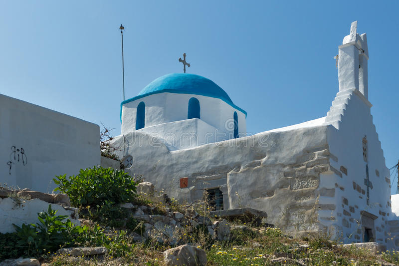 White chuch with blue roof in town of Parakia, Paros island, Greece. White chuch with blue roof in town of Parakia, Paros island, Cyclades, Greece royalty free stock images