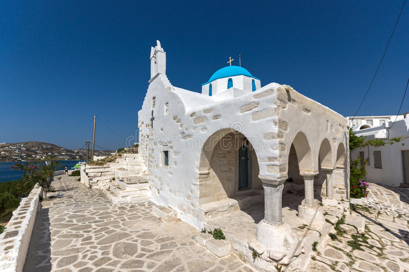 White chuch with blue roof in town of Parakia, Paros island, Greece. White chuch with blue roof in town of Parakia, Paros island, Cyclades, Greece stock image
