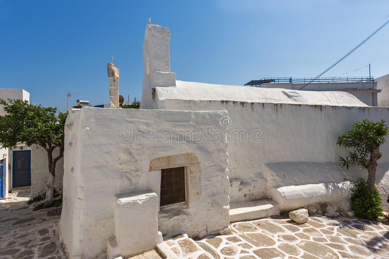 White chuch and street in town of Parakia, Paros island, Greece. White chuch and street in town of Parakia, Paros island, Cyclades, Greece royalty free stock image