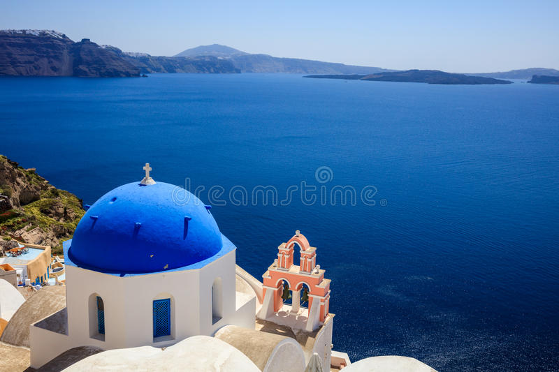 White church with blue dome in Santorini, Greece stock images