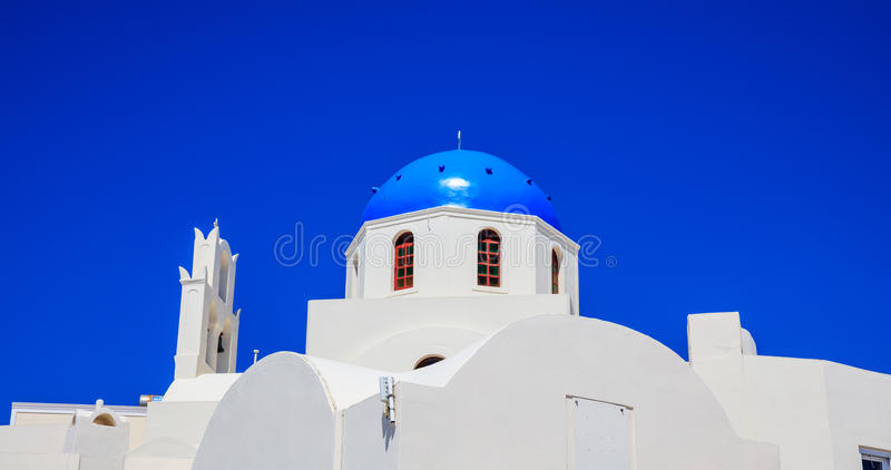 White church with blue dome in Santorini, Greece stock photography