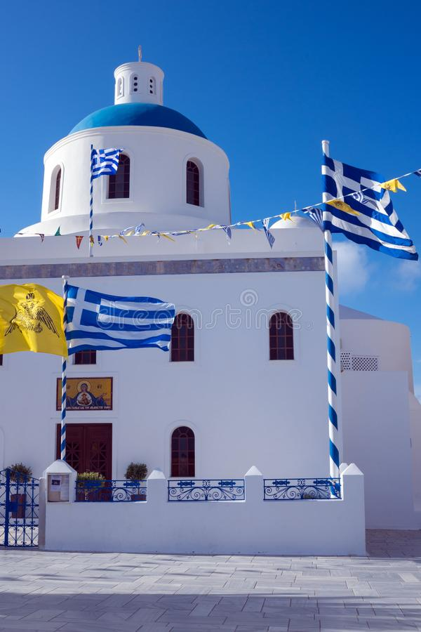 White Church with a blue dome in the village of Oia on the island of Santorini. Greek journey. royalty free stock photo