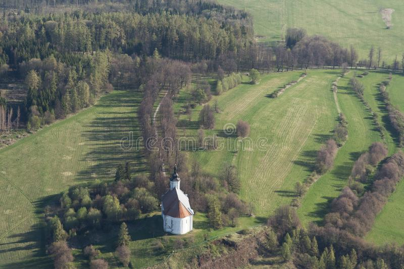 White church on a hill, aerial view stock photography