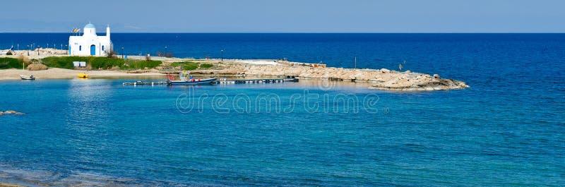 White church,Kalamies beach,protaras,cyprus. A panoramic view of a white greek orthodox church at Kalamies beach,protaras,cyprus stock image