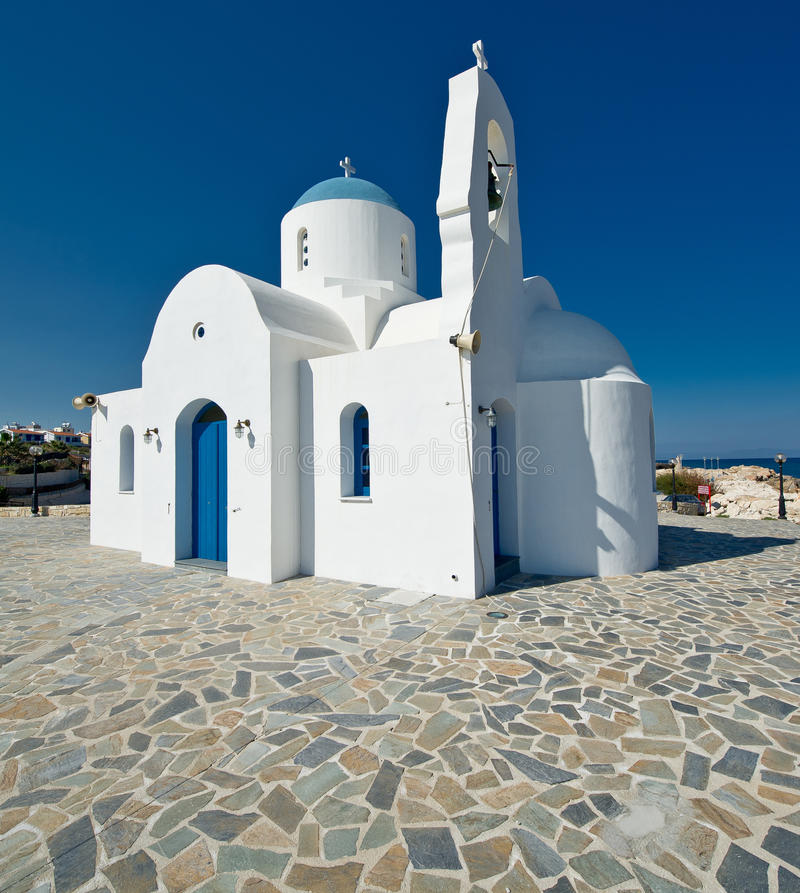 White church,Kalamies beach,protaras,cyprus. A view of a white greek orthodox church at Kalamies beach,protaras,cyprus royalty free stock photos