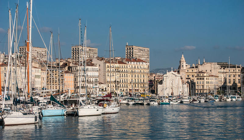 White church and the port of Marseille stock image