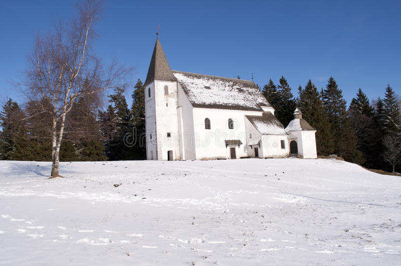 White church in snow royalty free stock images