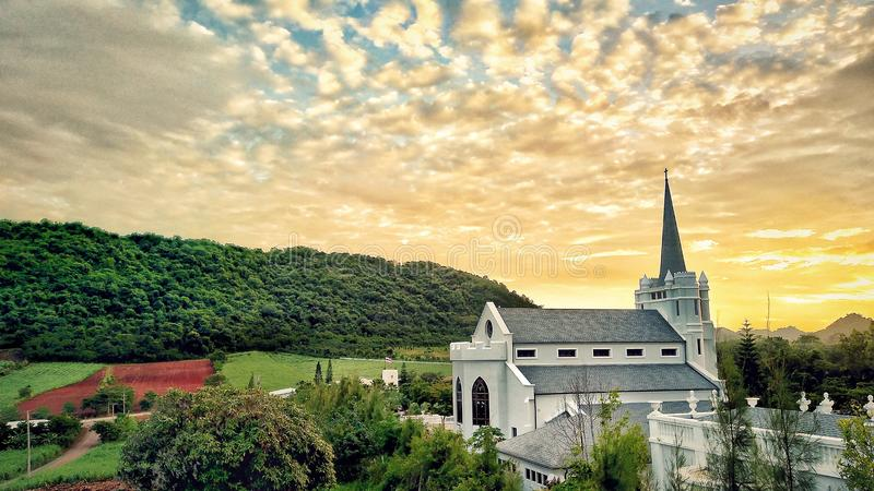 White church with sunset and mountain stock images