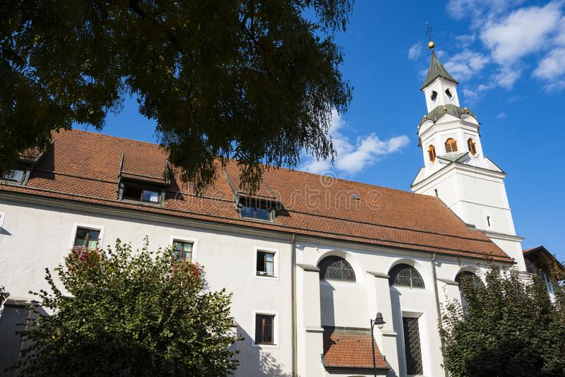 St Gotthard and St Erhard church, Bressanone Brixen, italy. White church with tower and orange roof tiles. St Gotthard, St Erhard. In Brixen Bressanone Italy stock photos