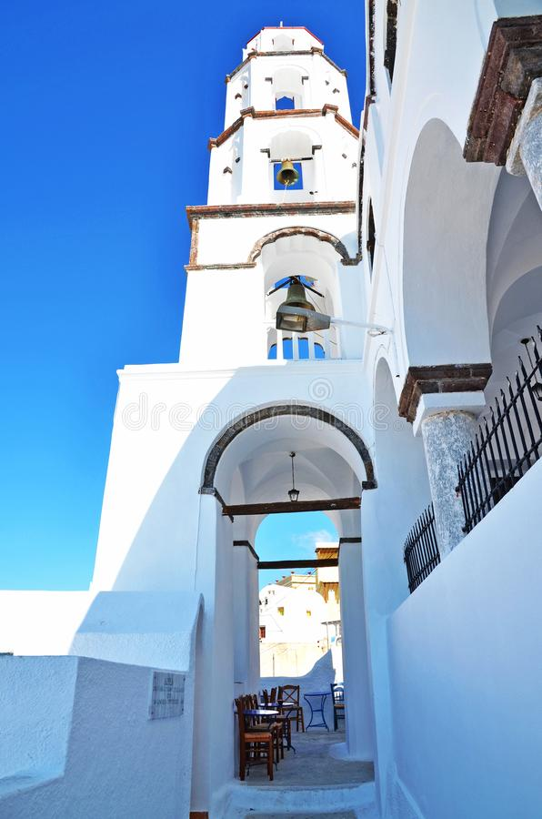 A white church tower in the village of Pyrgos, Santorini, Greece royalty free stock photography