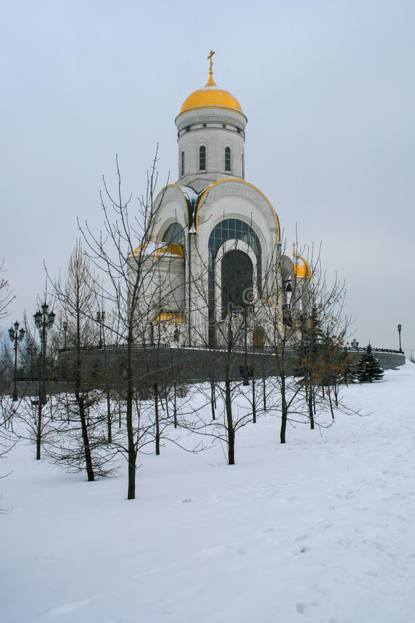 White church in the winter park. stock image