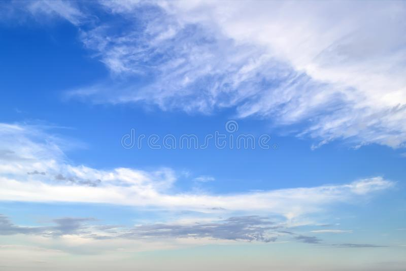 White cirrus and stratus clouds high in the blue summer sky. Different cloud types and atmospheric phenomena. Skyscape stock images