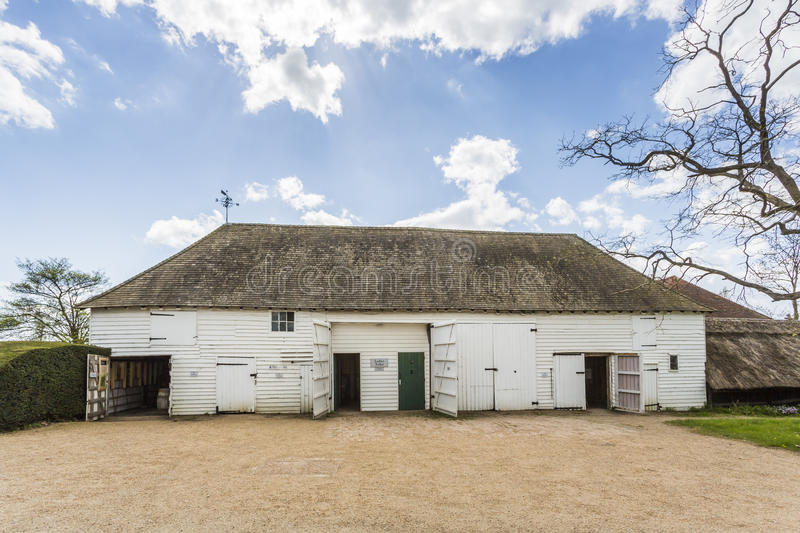 White clapboard barn at Great Dixter, East Sussex, south-east England royalty free stock photography