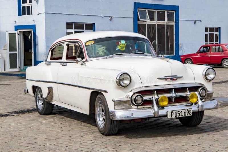 White classic american car - Taxi - Santiago de Cuba royalty free stock images