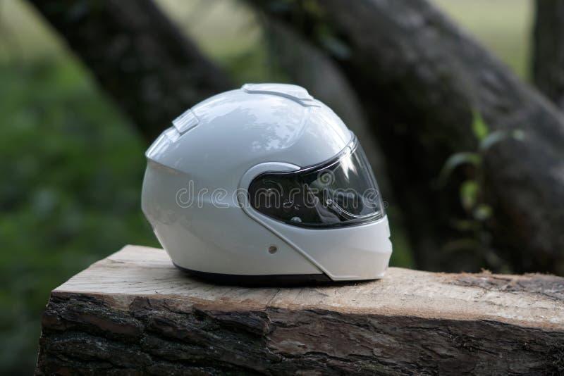 White classic motorcycle full face helmet stock image