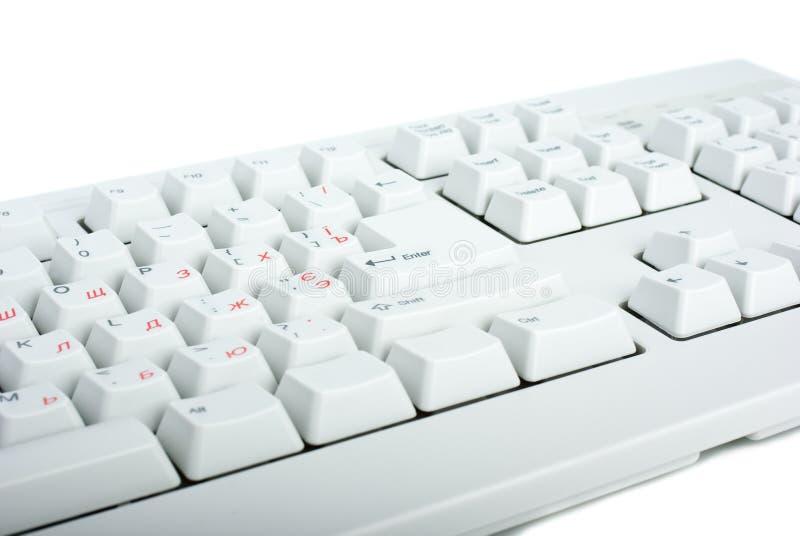 White classic PC keyboard fragment. White background stock photos