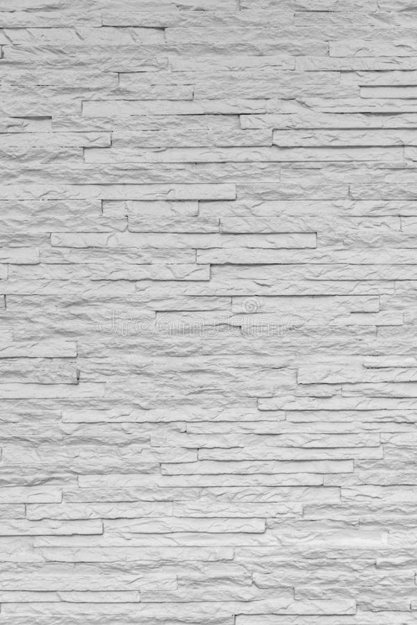 White classic stone brick are arranged to pattern on the wall for beautiful minimal and simple background stock image