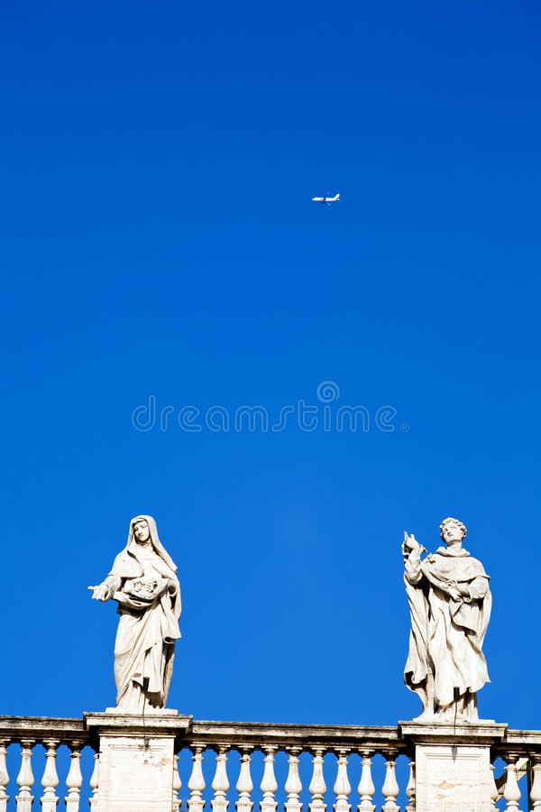 White classical statue and flying air in blue sky stock photography