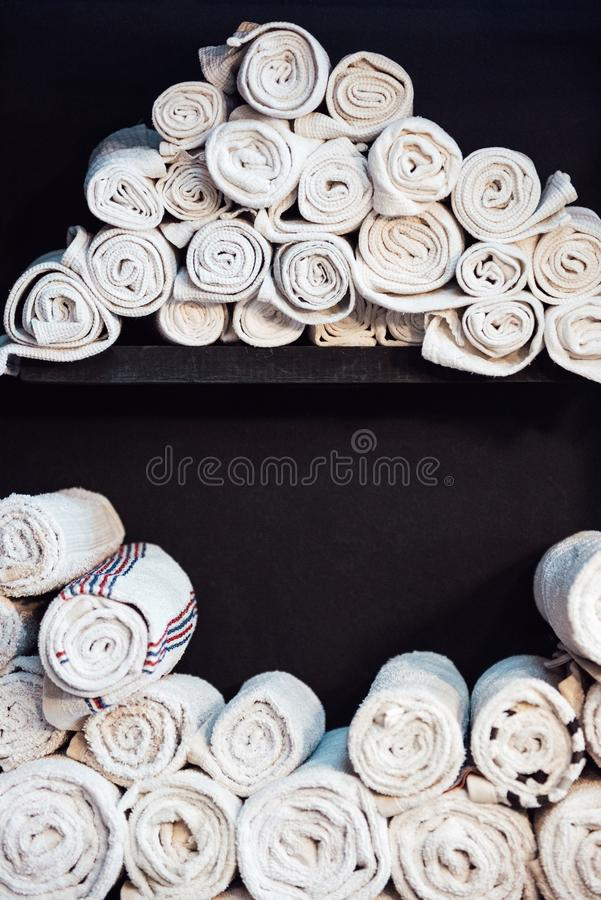 white clean barberman towels rolled a cylinder stock images