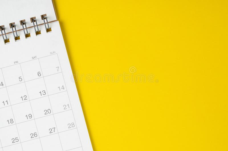White clean calendar on solid yellow background with copy space, royalty free stock image